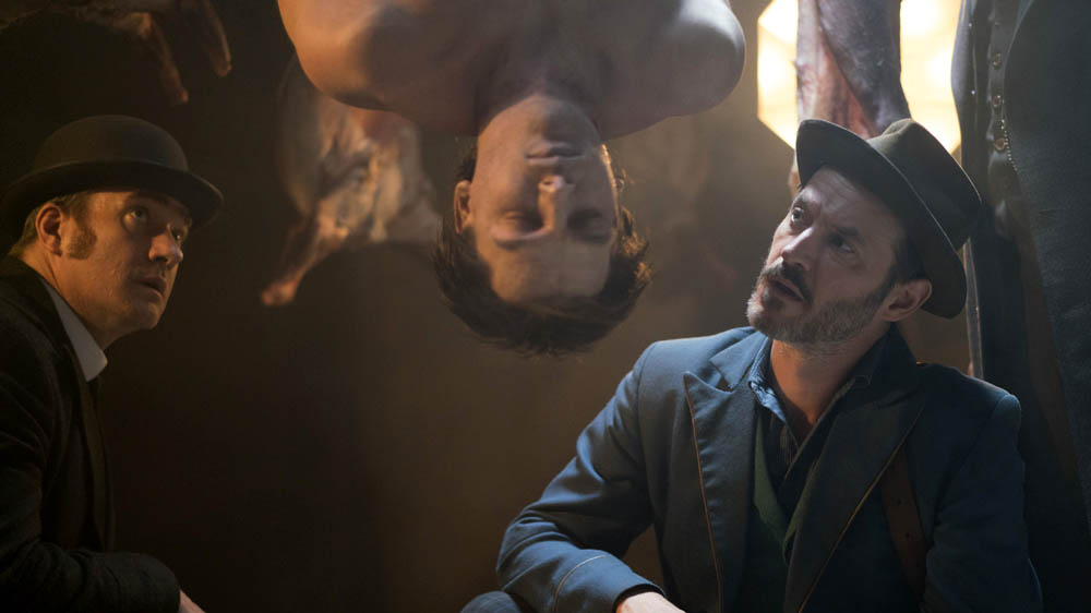Jackson and Reid examine a body in episode 4 of Ripper Street