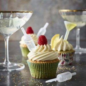 cupcakes with shot tops in them