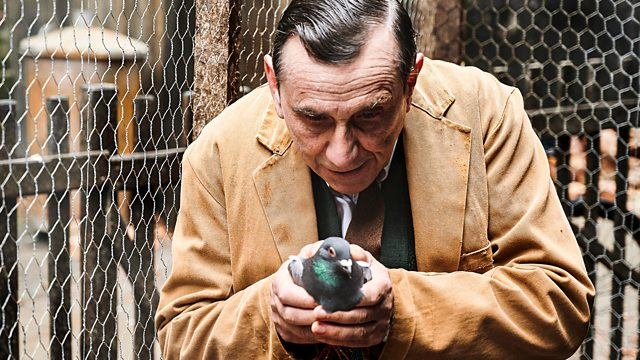 George holds one of his prize pigeons in episode 4 of Call the Midwife