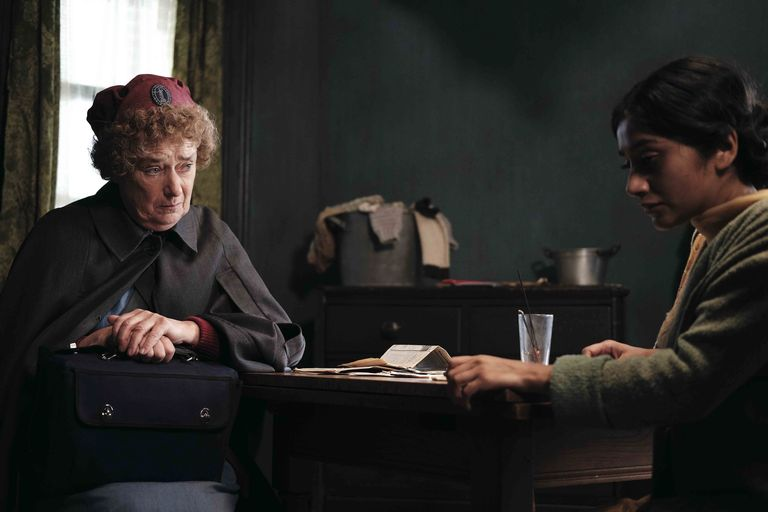 Nurse Crane speaks with a patient in episode 3 of Call the Midwife